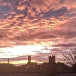 Red fluffy clouds over Preston