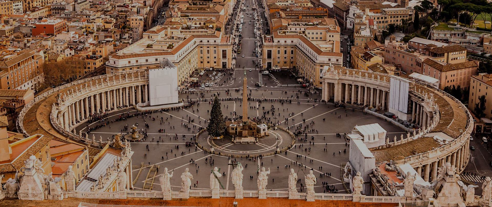 A view of the St. Peter's Basilica Plaza viewed from above, looking over the statues of the Apostles