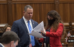 State Rep. Craig Fishbein discusses legislation with Rep. Tammy Nuccio during the May 27th legislative session.