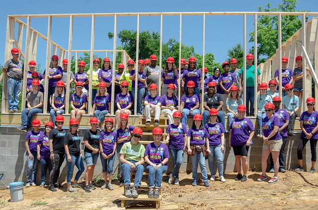 A group of volunteers at a construction site in