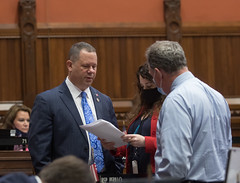 State Rep. Craig Fishbein discusses legislation with Rep. Tammy Nuccio and Rep. John Piscopo during the May 27th legislative session.