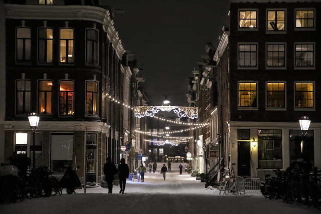 Night snow shopping in Amsterdam before curfew