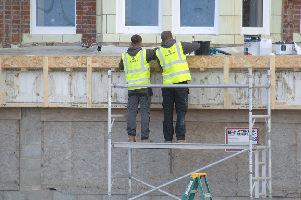 Yellow jacketed couple repairing a Blackpool hotel