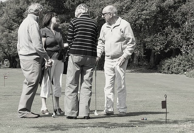 Discussing a shot on the putting course