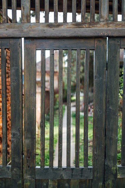 Wooden entrance gate with bars