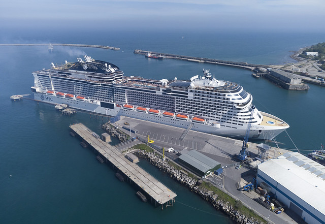 MSC Virtuosa aerial image - docked at Castletown - Portland Harbour, Dorset.