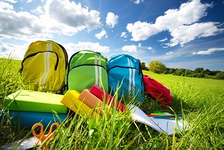Colourful,Children,Schoolbags,Outdoors,On,The,Field.,Backpacks,With,School