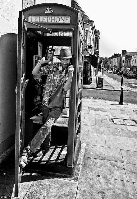 I'm in the phone booth, it's the one across the hall
