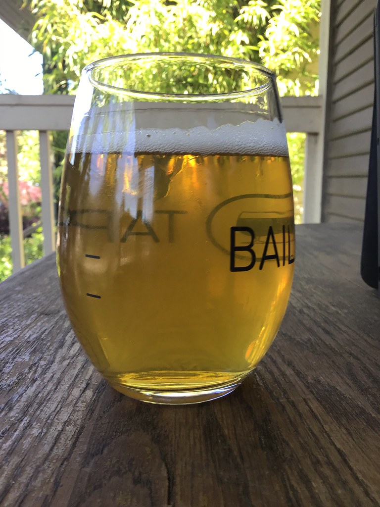 Arch Rock brewing Gold Beach lager in glass on table outdoors