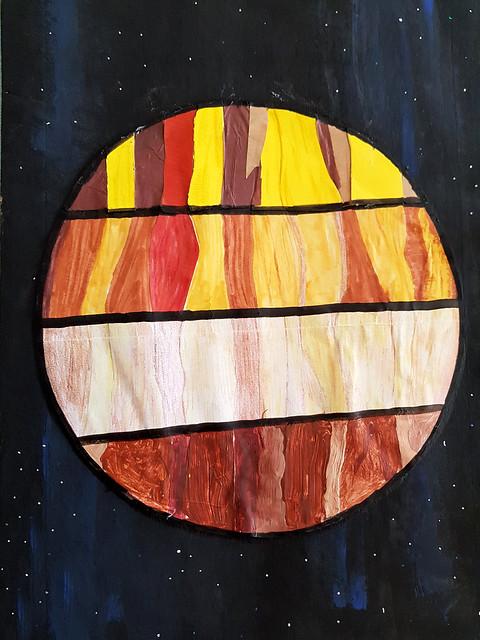 """142 - Giove in 4 stili di Emma 10 anni  Per la scelta di concentrarsi su Giove, un solo pianeta anziché tutta la corte del sole, e per averlo mostrato """"in 4 stili"""" che ricordano le osservazioni scientifiche in diverse frequenze dello spettro elettromagnetico."""