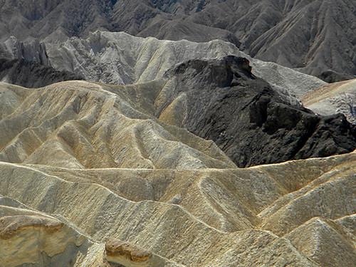 Textured landforms of Zabriskie Point in Death Valley desert with its badlands eroded by wind and flash floods