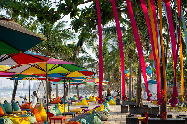 Cho Ca Go Beach Bar with Colorful Bean Bags, Wooden Tables, Sun Umbrellas and Decorations at My Khe Beach in Da Nang, Vietnam