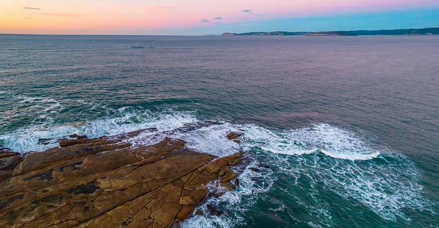 Aerial sunrise panorama over the sea