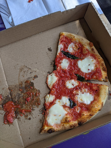 half a pizza from the Tipsy Tomato