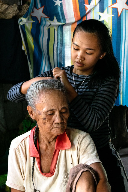 Fre-an breading the hair of her lola