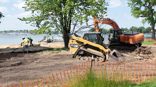 Photo of heavy equipment and workers restoring a shoreline