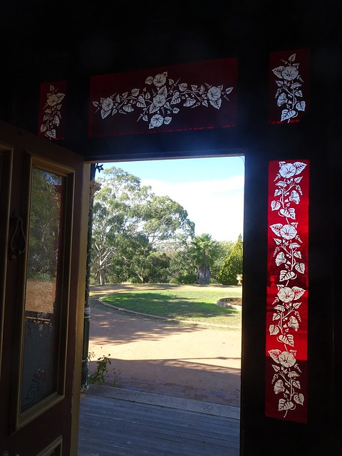Junee. Monte Cristo House built in 1884 and supposedly haunted. Beautiful red glass and flower pattern around the front  door . . .