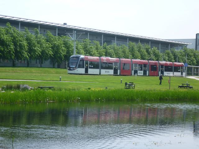 Tram 260 departs Edinburgh Park Central en route to Edinburgh Airport.