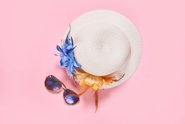 Summer vacation concept with travel accessories - female hat and sunglasses