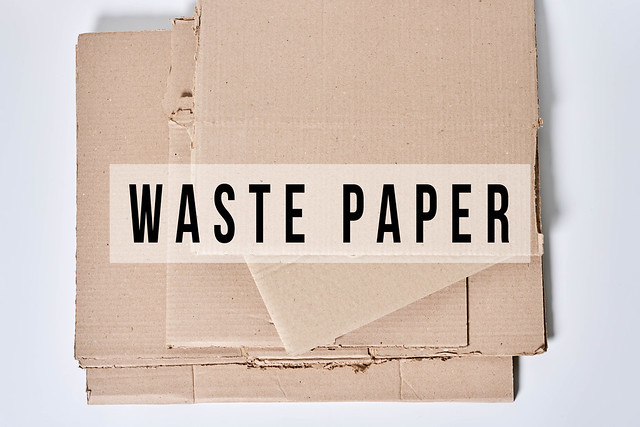 Heap of cardboard for recycling with text - Waste paper