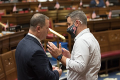 State Rep. Craig Fishbein talks with Rep. Greg Howard about Judiciary legislation during a House session on Friday, June 4, 2021.