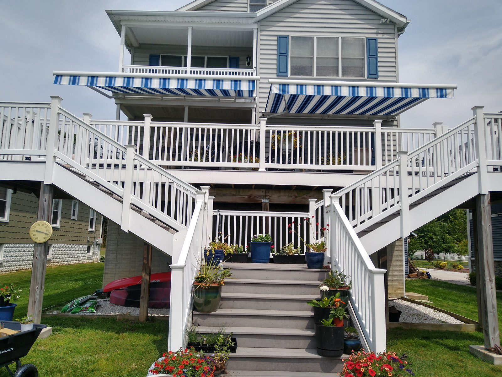 Dual Blue and White Striped Retractable Awnings