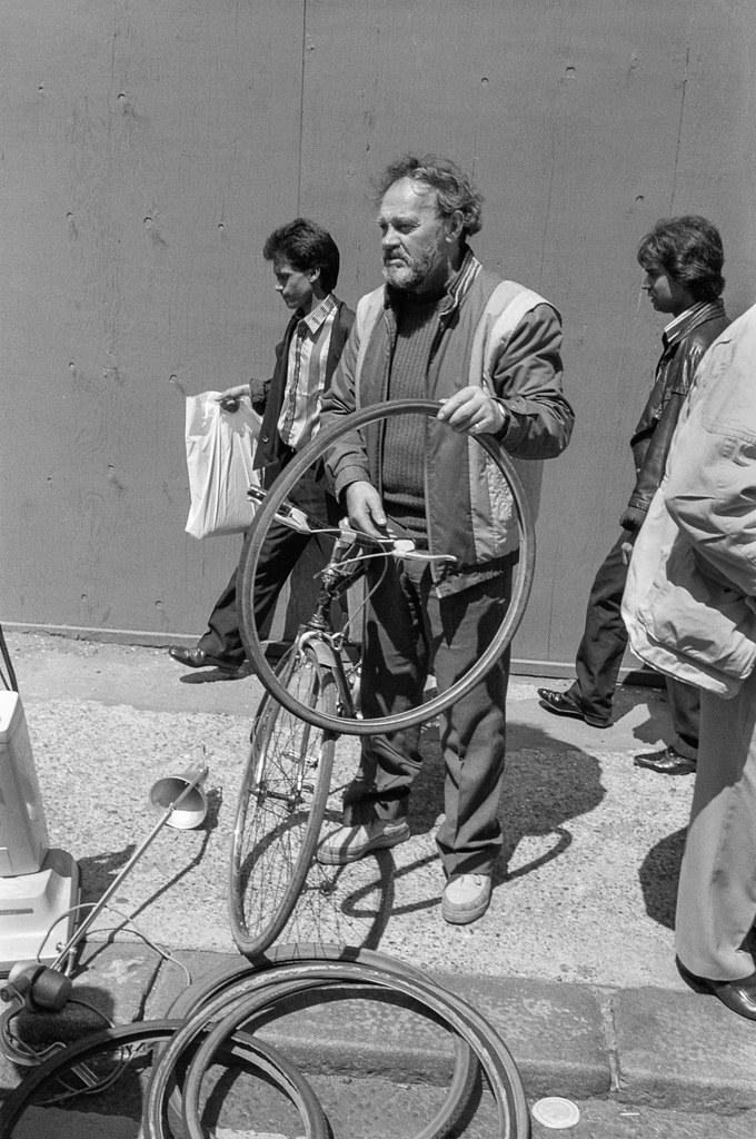Man with bike tyres, Brick Lane market, Tower Hamlets, 1990, 90-72-41