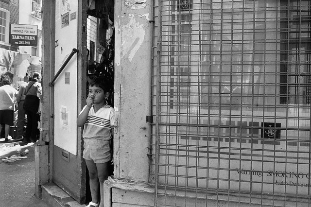 Boy in Doorway, Brick Lane, Tower Hamlets, 1990, 90-72-55