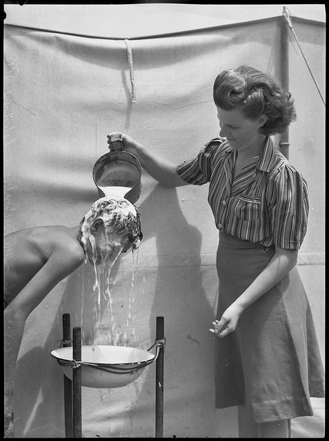 Boy getting his hair washed, Narrabeen camp, 26 January 1944, by Alec Iverson