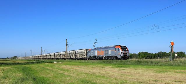 HVLE 159 010 mit GATX Leerzug bei Abelitz.