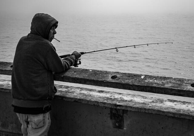 Fishing Man on the Pier