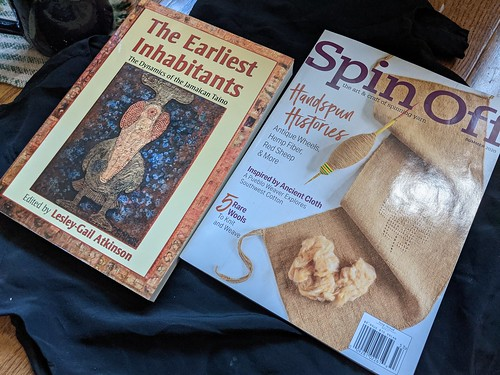 Book the Earliest Inhabitants by Lesley-Gail Atkinson and Spin Off magazine summer 2020 issue on black silk cloth.