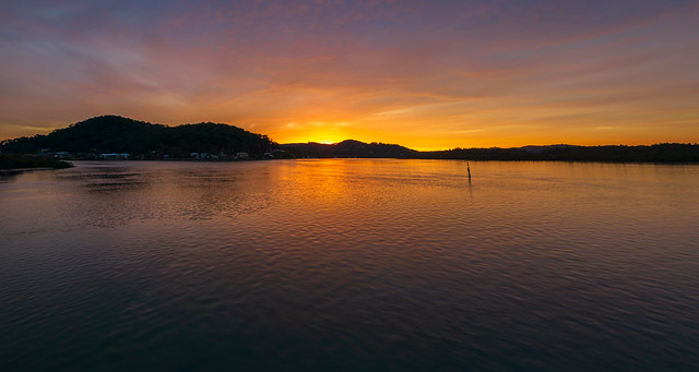 High cloud covered winter sunrise panorama waterscape