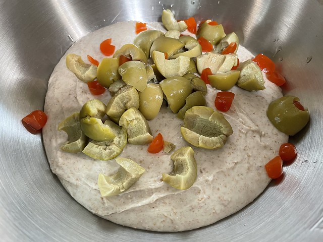 Mixing olives and pimentos