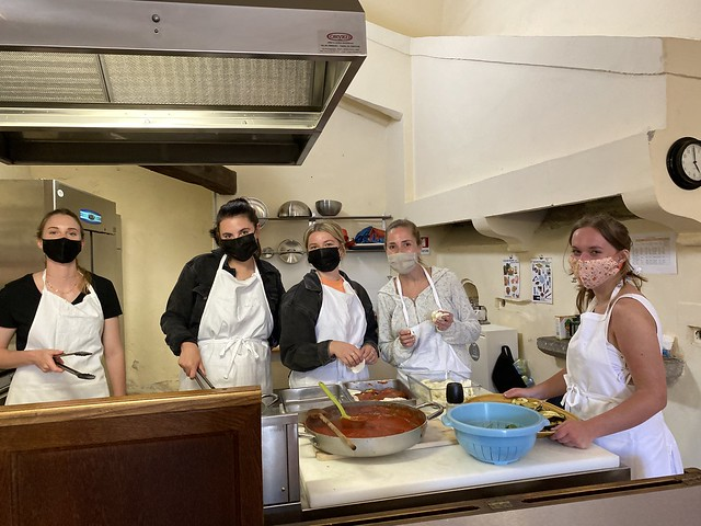 Students cook a meal in the kitchen of the Chigi Palace in Ariccia, Italy.