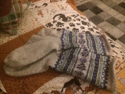 Diane's daughter gave her the Knit Like a Latvian book so she is knitting socks like these with Drops Flora!