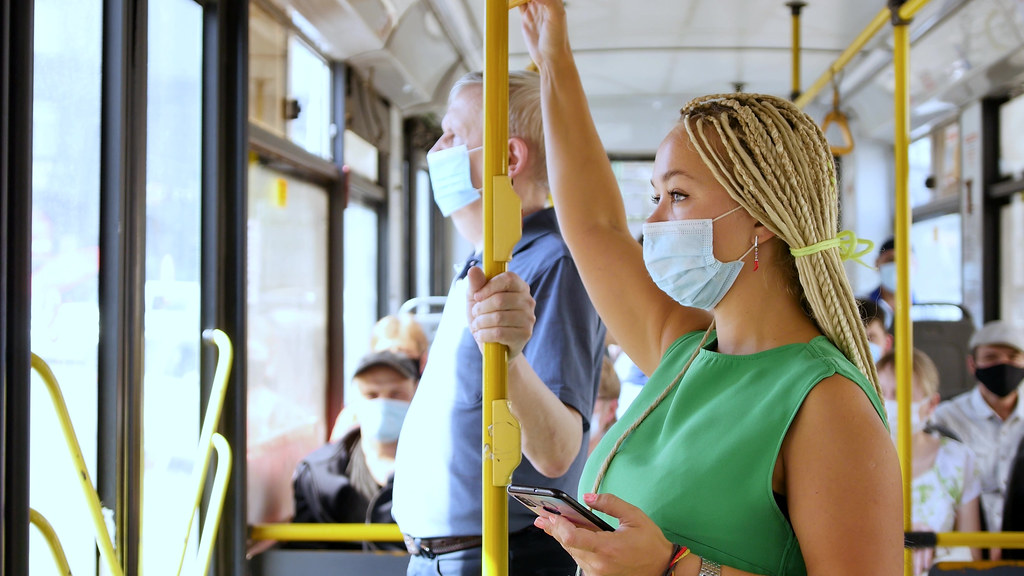 Woman wearing mask on a bus