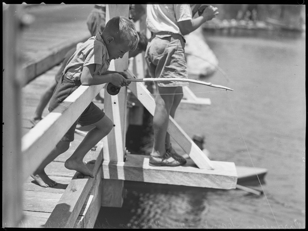 Boy fishing, Narrabeen camp war workers holiday, 26 January 1944, by Alec Iverson