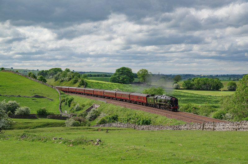 Merchant Navy Pacific 35018 'British India Line' races through the cuttings at Waitby in charge of 'The Pendle Dalesman' on June 8th 2021.
