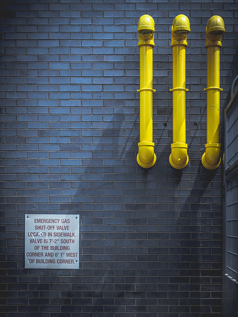yellow pipes / blue wall
