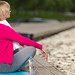 Closeup Portrait of Mature Caucasian Blond Woman During Yoga Practice on Blue Mat At Water Shore Outdoor.