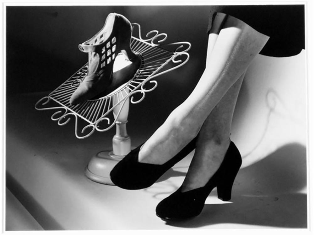 Modelling of shoes for David Jones, 1953, by Max Dupain and Associates
