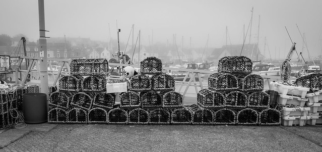 Stacked fishing pots, Anstruther Harbour, Anstruther, Fife, Scotland, UK