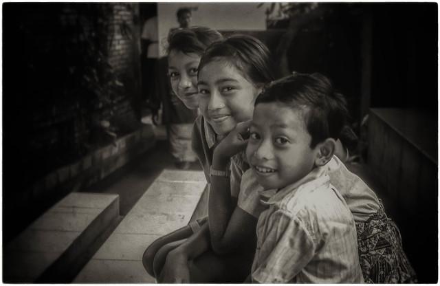 Bali - Village children enjoying performance of the Barong and Kris Dance.