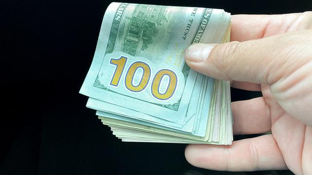 A hand full of cash money