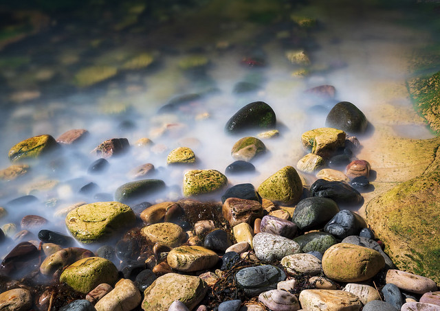 Water laps against rocks, Anstruther Harbour, Anstruther, Fife, Scotland, UK
