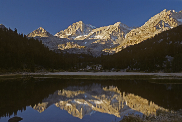 Bear Creek Spire, 13,720'/4180m. and other peaks reflected in early morning light in Long Lake at the end of the Little Lakes Valley in the Sierra Nevada Mountains of California.
