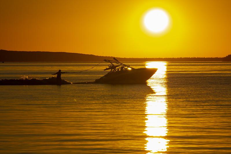 Wake boarding at sunset, Waskesiu Lake, Prince Albert National Park