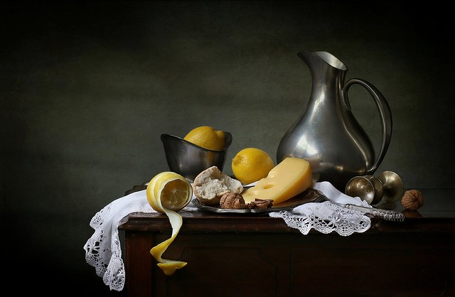 Still life with cheese and lemons