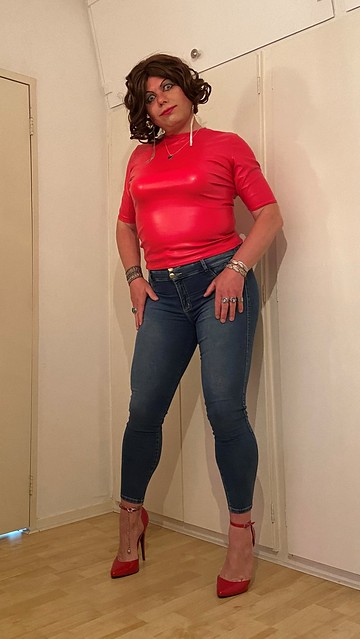tight denim, red leather and a toe cleavage in red heels